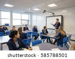male teacher is teaching a... | Shutterstock . vector #585788501