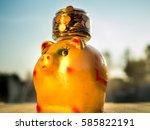 the money jay on golden piggy... | Shutterstock . vector #585822191