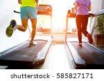 people running on a treadmill | Shutterstock . vector #585827171