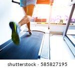 people running on a treadmill | Shutterstock . vector #585827195