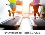 people running on a treadmill | Shutterstock . vector #585827231