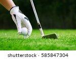 hand putting golf ball on tee...   Shutterstock . vector #585847304