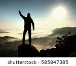 happy man with raised arms... | Shutterstock . vector #585847385