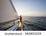 man looking at beautiful sea... | Shutterstock . vector #585853259
