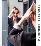 Small photo of laughing young beautiful business woman with smart jacket enjoying looking at her home mirror, checking her hair before work for dynamic and extrovert morning routine