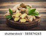 fresh ginger root on the wooden ... | Shutterstock . vector #585874265