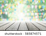 empty wooden table with party... | Shutterstock . vector #585874571
