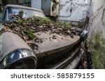 old car with moss and fallen... | Shutterstock . vector #585879155