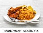 jollof rice with chicken and... | Shutterstock . vector #585882515