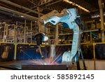 industrial robot is welding... | Shutterstock . vector #585892145