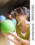 two women with bowling balls ... | Shutterstock . vector #585915581