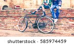 young people with retro bike... | Shutterstock . vector #585974459