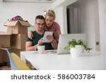 young couple moving in a new... | Shutterstock . vector #586003784
