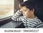 Sad Boy Next To A Window