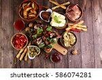 italian antipasti snacks set.... | Shutterstock . vector #586074281