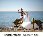 young pretty fashion woman... | Shutterstock . vector #586074521