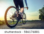 athlete cycling on the road in... | Shutterstock . vector #586176881