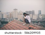 an asia young girl on the top... | Shutterstock . vector #586209935