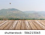 empty top of wooden table and... | Shutterstock . vector #586215065