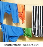 hanging clothes | Shutterstock . vector #586275614