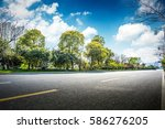asphalt road and forest | Shutterstock . vector #586276205
