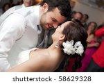 Bride And Groom Dancing In...