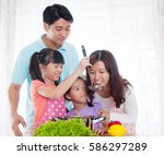 asian family cooking in the... | Shutterstock . vector #586297289