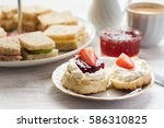 Stock photo traditional english afternoon tea scones with clotted cream and jam strawberries with various 586310825