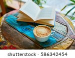 cup of fresh coffee and book on ... | Shutterstock . vector #586342454