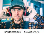 factory worker wearing hearing... | Shutterstock . vector #586353971