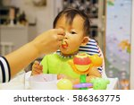 asian baby eating time | Shutterstock . vector #586363775