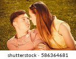 Small photo of Love romance relationship dating relax concept. Affectionate couple on grass. Young enamoured girl and boy show affection in park.
