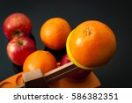 Small photo of The idiom, comparing apples and oranges, refers to the differences between incomparable or incommensurable items. The concept is illustrated by 2 groups of apples and oranges on a balance scale