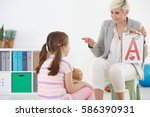 speech therapist and child with ... | Shutterstock . vector #586390931