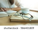 women reading book with coffee... | Shutterstock . vector #586401809