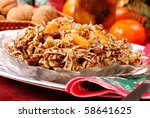 traditional  polish noodles with poppy seeds , dried fruits and honey as dessert  for christmas eve - stock photo