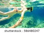 snorkel couple swimming...   Shutterstock . vector #586480247