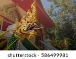 king of naga in buddist temple   Shutterstock . vector #586499981