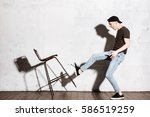 hipster in snap back kicking... | Shutterstock . vector #586519259