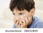 Autism, kid looking far away without interesting - stock photo