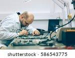 technician fixing motherboard...   Shutterstock . vector #586543775