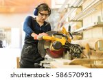 attractive female carpenter... | Shutterstock . vector #586570931