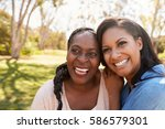 mother and adult daughter in... | Shutterstock . vector #586579301
