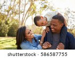 parents carrying son on... | Shutterstock . vector #586587755