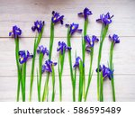 Blue Irises On A Wooden...