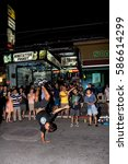 Small photo of Phuket, Thailand, January 27, 2017: A young man dancing in front of the audience on Bangla Road.