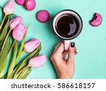 Woman\'s Hand Holding Cup With...