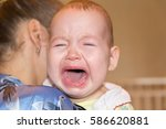 mom soothes baby. the baby is... | Shutterstock . vector #586620881