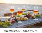 picnic on the beach at sunset...   Shutterstock . vector #586624271
