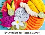 tropical fruits assortment on a ...   Shutterstock . vector #586666994